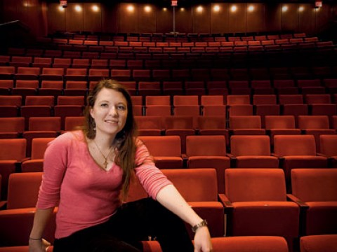 Mary Ellen Stebbins sits under the lights in the New College Theatre.