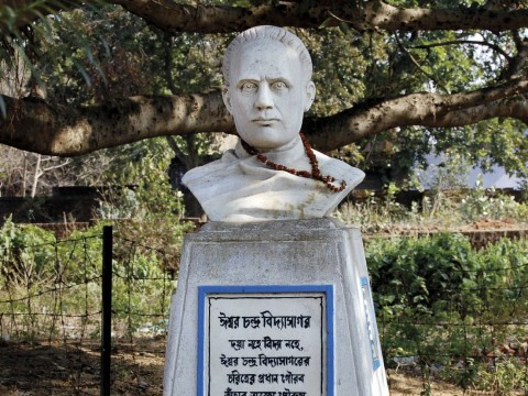"The inscription below this bust of Vidyasagar quotes Rabindranath Tagore: ""The chief glories of [his] character were neither his compassion nor his learning, but his invincible manliness and imperishable humanity."" The presence of a garland speaks to the reverence many still feel for the man."