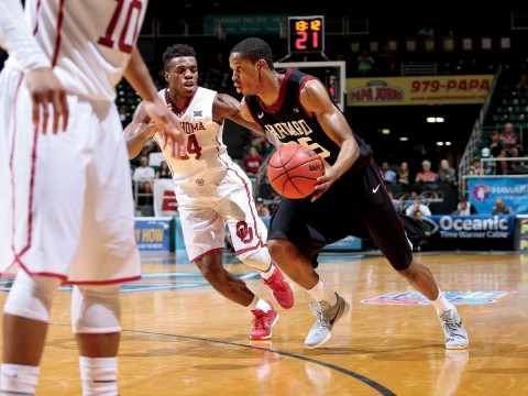 Agunwa Okolie '16, the Ivy League Defensive Player of the Year, helped the Harvard men's basketball team remain competitive during an injury-plagued season.