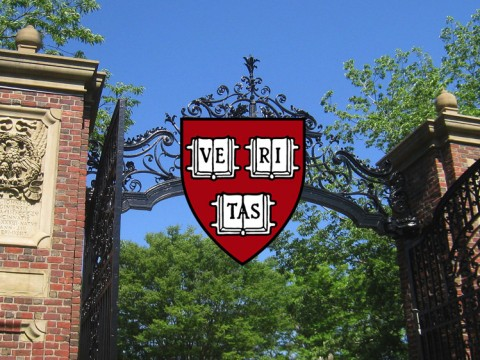 An open gate with the Harvard Logo over it