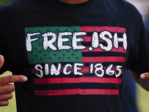 Photograph of someone wearing a Juneteenth T-shirt