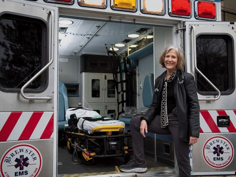 Pediatrician Eileen Costello stands next to the Boston Medical Center's mobile pediatric clinic.