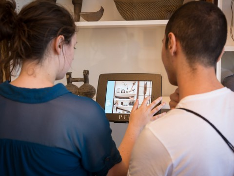 Brianna Macgregor '16 and Ozdemir Vayisoglu '16, both fellows at the Summer Humanities and Arts Research Program, digitally access information about an object at the Peabody Essex Museum (PEM) in Salem, Massachusetts, during a workshop on cultural interpretation.