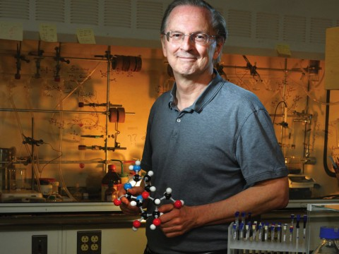 Jack Szostak, in his lab at Massachusetts General Hospital, holds a model of a nucleic acid.