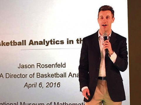 Jason Rosenfeld delivers a presentation with microphone in hand