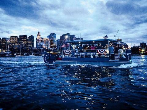 Boat cruising on Boston harbor at twilight