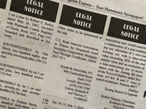 A page from a newspaper showing legal notices