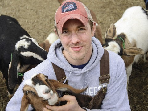Max Sandvoss with some of his goats at the First Light Farm and Creamery in East Bethany, New York