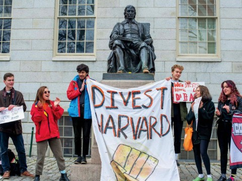 The author and fellow activists at a Divest Harvard rally this past April: (from left) Caleb Schwartz '20, Flores-Jones, Anand Bradley '19, Owen Torrey '21, Eva Rosenfeld '21, and Sophia Higgins '21