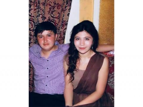 Photograph of Ekpar Asat and Rayhan Asat.