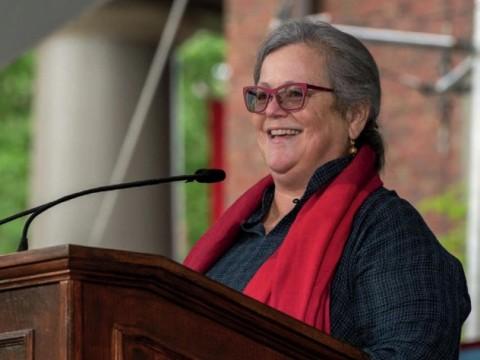 Alice Hill at podium speaking