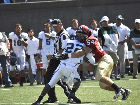 A not-quite-irresistible force meets an immovable object: Crimson linebacker Brian Reilly stopping San Diego tailback Kenn James in Saturday's Stadium opener. The visitors'  running backs netted just 35 yards rushing against a staunch Harvard defense.