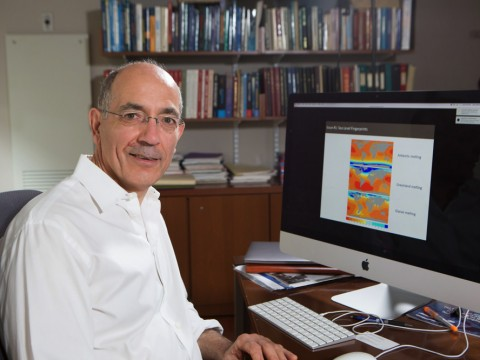 A portrait of Jerry Mitrovica at his desk