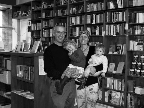 Happily at home: Brian Buckley, Katherine Hunter, and their children in the family's poetry bookstore in Boulder.