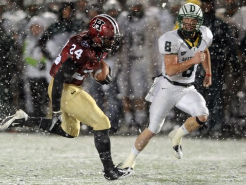 With wet snow veiling the Stadium's FieldTurf surface, tailback Treavor Scales '13 had his best game of the season against Dartmouth, rushing for 139 yards and two touchdowns. Cornerback Shawn Abuhoff is the Big Green defender.