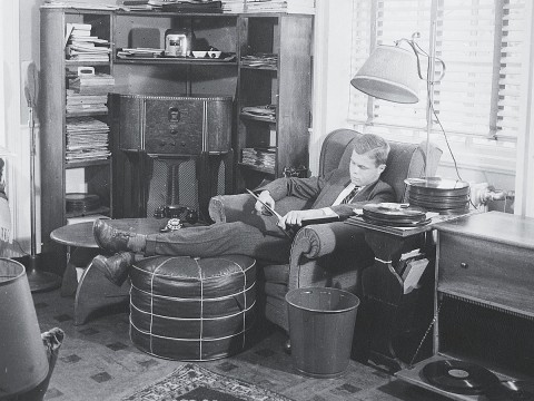 A 1940s undergraduate listens to records in his suite.
