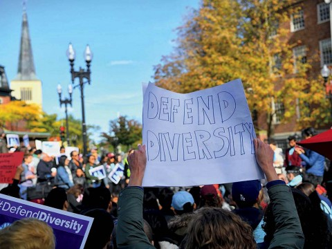 "Supporters of affirmative action protest in Harvard Square. A poster reads, ""Defend Diversity."""