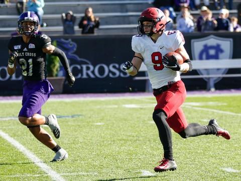 Harvard senior Cody Chrest runs with ball in hand