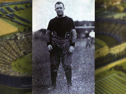 Charles Brickley pictures alone in an old-fashioned football uniform