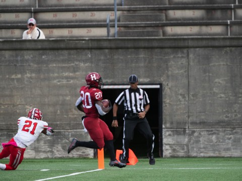 Harvard junior running back Aaron Shampklin eludes the desperate lunge of Cornell's Kenan Clarke to score the clinching touchdown.