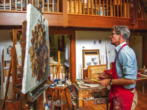 Jason Bouldin at work on a painting in his studio