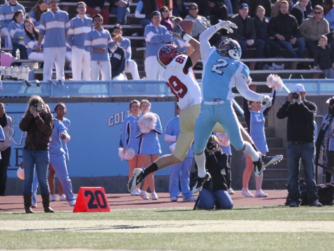 Receiver Chris Lorditch outjumped Columbia cornerback Brian DeVeau to snare a pass from quarterback Collier Winters in the third period of Saturday's game at Wien Stadium. Dodging two more Lion defenders, Lorditch dove into the end zone for a 41-yard touchdown, Harvard's fourth of the afternoon.