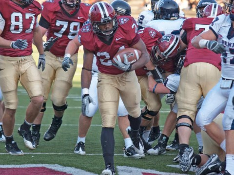 Junior tailback Treavor Scales was Harvard's top ground-gainer against Pennsylvania. His 70 yards rushing included a 35-yard breakaway, setting up a two-yard touchdown run (above) at the start of the final quarter. The Penn defender is linebacker Erik Rask.
