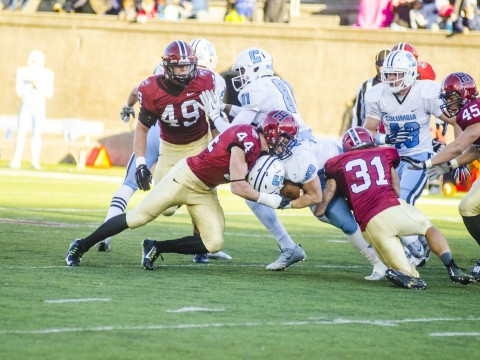 Not going anywhere? Columbia's Turner DeMuth ran into a posse of Harvard tacklers, including linebacker Eric Medes '16 (number 49), defensive back Scott Peters '16 (44), defensive back Jordan Becerra '16 (31) and linebacker Chase Guillory '18 (45).