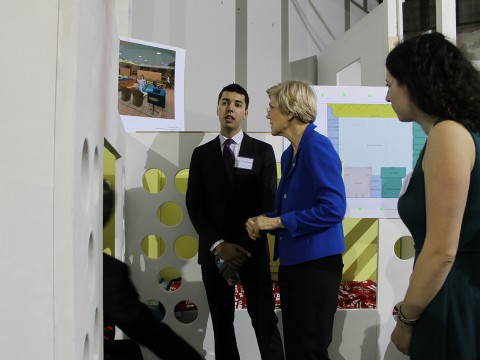 Sam Greenberg '14 and Sarah Rosenkrantz '14 walk Senator Elizabeth Warren through the soon-to-be-finished shelter.