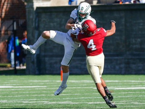Harvard defensive back Max Jones knocks a ball out of the hands of Dartmouth wide receiver Drew Estrada