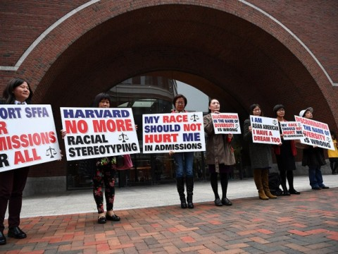 "Photograph of demonstrators in front of the federal courthouse in Boston where the SFFA v. Harvard trial took place, with signs reading ""Harvard No More Racial Stereotyping"" and ""My Race Should Not Hurt Me In Admissions."