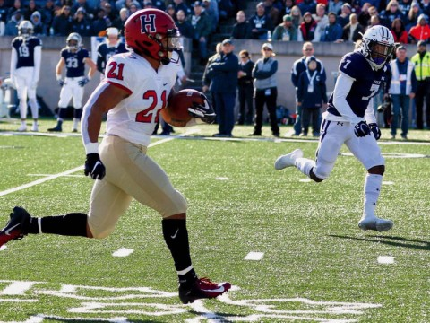 Photograph: With Yale's Melvin Rouse II in vain pursuit, Harvard's Aidan Borguet heads for the goal line.