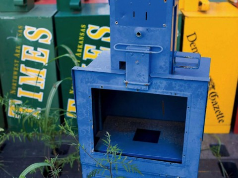 Photo of abandoned newspaper vending boxes
