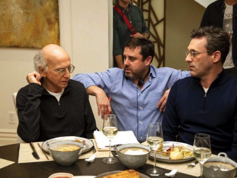 "Producer Jeff Schaffer sits between star Larry David (left) and another cast member on the ""Curb Your Enthusiasm"" set."