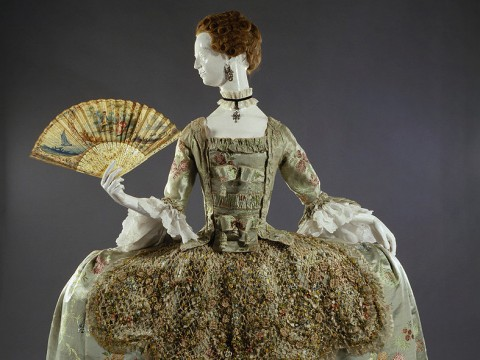 Ornate eighteenth-century dress with wide hooped skirt